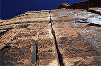 A rock climber tackles an overhanging crack in a sandstone wall on the cliffs of Indian Creek, a famous rock climbing area in Canyonlands National Park, near Moab, Utah, United States of America, North America Stock Photo - Premium Rights-Managednull, Code: 841-03675354