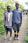 Two schoolboys in make-do school uniform, one barefoot, with white cotton fabric pinned in place of school tie, Langalanga Primary School, Gilgil district, Rift Valley, Kenya, East Africa, Africa Stock Photo - Premium Rights-Managed, Artist: Robert Harding Images, Code: 841-03675378