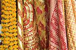 Red and gold tinselled cloths for Hindu devotees visiting a temple, and marigold flower garlands, Guwahati, Assam, India, Asia Stock Photo - Premium Rights-Managed, Artist: Robert Harding Images, Code: 841-03675398