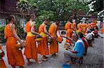 Monks processing at dawn for alms of rice in Luang Prabang, Laos, Indochina, Southeast Asia, Asia Stock Photo - Premium Rights-Managed, Artist: Robert Harding Images, Code: 841-03676046
