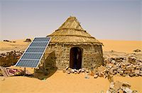 Traditional house with a solar panel in the Sahara Desert, Algeria, North Africa, Africa Stock Photo - Premium Rights-Managednull, Code: 841-03676338