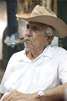 Cuban emigre smoking cigar wearing a cowboy hat in Calle Ocho, Miami, Florida, United States of America, North America Stock Photo - Premium Rights-Managednull, Code: 841-03677108