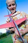 Boy playing with a model aeroplane. Stock Photo - Premium Royalty-Free, Artist: Cusp and Flirt, Code: 679-03677979
