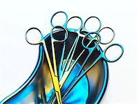 Surgical instruments in a dish. Stock Photo - Premium Royalty-Freenull, Code: 679-03680788