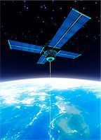Space elevator. Computer artwork of a space station in geostationary orbit attached to a space elevator made from carbon nanotubes. Stock Photo - Premium Royalty-Freenull, Code: 679-03680901