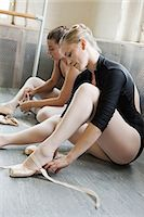 Ballerinas putting on ballet slippers Stock Photo - Premium Royalty-Freenull, Code: 614-03684378