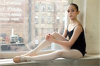 Ballerina sitting on windowsill Stock Photo - Premium Royalty-Freenull, Code: 614-03684438