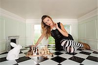 Young woman playing chess with rabbit Stock Photo - Premium Royalty-Freenull, Code: 614-03684568