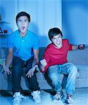 Shouting teenage boys watching television Stock Photo - Premium Royalty-Freenull, Code: 635-03684964