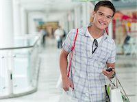 Teenage boy shopping in mall Stock Photo - Premium Royalty-Freenull, Code: 635-03685022
