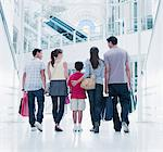 Family carrying shopping bags in mall Stock Photo - Premium Royalty-Freenull, Code: 635-03685087