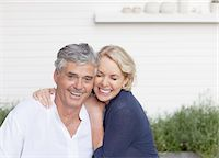 Smiling couple hugging outdoors Stock Photo - Premium Royalty-Freenull, Code: 635-03685105