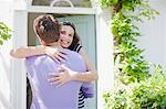 Couple hugging on front stoop Stock Photo - Premium Royalty-Freenull, Code: 635-03685127