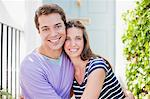 Couple hugging on front stoop Stock Photo - Premium Royalty-Freenull, Code: 635-03685128