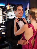 Elegant woman fixing husband's bowtie Stock Photo - Premium Royalty-Freenull, Code: 635-03685442