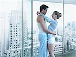 Couple hugging with cityscape in background Stock Photo - Premium Royalty-Free, Artist: Ron Fehling, Code: 635-03685465
