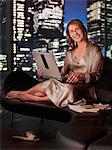 Woman in nightgown using laptop at night Stock Photo - Premium Royalty-Freenull, Code: 635-03685491