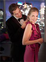 Husband in tuxedo fastening elegant wife's necklace Stock Photo - Premium Royalty-Freenull, Code: 635-03685501