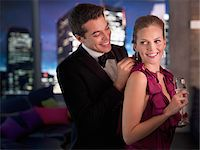 Husband in tuxedo fastening elegant wife's necklace Stock Photo - Premium Royalty-Freenull, Code: 635-03685502