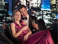 Elegant couple drinking Champagne at night Stock Photo - Premium Royalty-Freenull, Code: 635-03685537