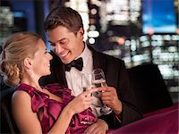 Elegant couple drinking Champagne at night Stock Photo - Premium Royalty-Freenull, Code: 635-03685538