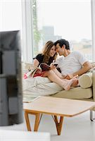 Couple sitting on sofa drinking red wine Stock Photo - Premium Royalty-Freenull, Code: 635-03685554