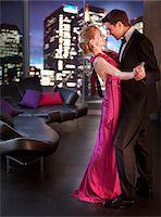 Elegant couple dancing in living room Stock Photo - Premium Royalty-Freenull, Code: 635-03685558