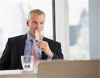 Businessman drinking white wine in restaurant Stock Photo - Premium Royalty-Freenull, Code: 635-03685604