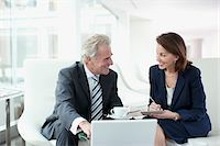 Business people working and drinking coffee Stock Photo - Premium Royalty-Freenull, Code: 635-03685610