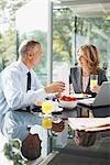 Smiling business people having breakfast Stock Photo - Premium Royalty-Free, Artist: Mike Randolph, Code: 635-03685685