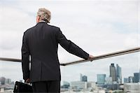 Businessman standing on urban balcony Stock Photo - Premium Royalty-Freenull, Code: 635-03685699