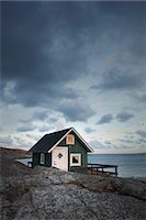 Hut on Shoreline at Sunset, Bohuslaen, Vastra Gotaland County, Gotaland, Sweden Stock Photo - Premium Rights-Managednull, Code: 700-03685775