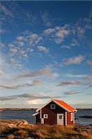 Red Wooden Hut on Shoreline, Bohuslaen, Vastra Gotaland County, Gotaland, Sweden Stock Photo - Premium Rights-Managednull, Code: 700-03685779