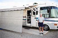 Man Standing in front RV in Trailer Park, Yuma, Arizona, USA Stock Photo - Premium Rights-Managednull, Code: 700-03686137