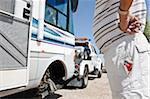 Man Watching RV being Towed in Desert, near Yuma, Arizona, USA