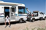 Man with Broken Down RV and Tow Truck in Desert, near Yuma, Arizona, USA
