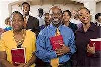 Sunday Service Congregation standing in church with Bibles, portrait Stock Photo - Premium Royalty-Freenull, Code: 693-03686351