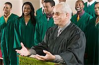 Minister Preaching in Front of Gospel Choir Stock Photo - Premium Royalty-Freenull, Code: 693-03686355