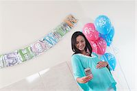 pregnant low angle - Pregnant Woman with Her New Baby Monitor at baby shower Stock Photo - Premium Royalty-Freenull, Code: 693-03686524