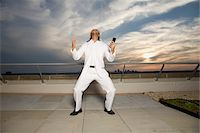 Man Screaming on Rooftop Stock Photo - Premium Royalty-Freenull, Code: 600-03692069