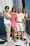 Family smiling on Sailboat, (portrait) Stock Photo - Premium Royalty-Freenull, Code: 694-03692324