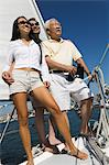 Family on sailboat Stock Photo - Premium Royalty-Freenull, Code: 694-03692336