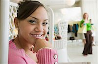Girl Hanging Out in Boutique, portrait, close up Stock Photo - Premium Royalty-Freenull, Code: 694-03692427