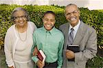 Christian Grandparents and Grandson in garden holding Bibles, portrait Stock Photo - Premium Royalty-Freenull, Code: 694-03692507