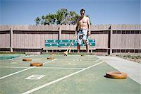 Man Playing Shuffleboard in Trailer Park, Yuma, Yuma County, Arizona, USA Stock Photo - Premium Royalty-Freenull, Code: 600-03696945
