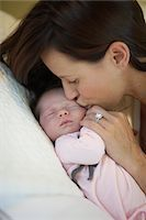 Mother Kissing Baby Girl, Burnaby, British Columbia, Canada Stock Photo - Premium Royalty-Freenull, Code: 600-03697009