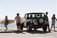 Friends by vehicle with surfboards Stock Photo - Premium Royalty-Freenull, Code: 614-03697600
