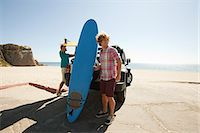 Two young men with surfboards Stock Photo - Premium Royalty-Freenull, Code: 614-03697649