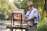 Artist painting outdoors Stock Photo - Premium Royalty-Freenull, Code: 621-03698661