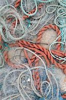 Detail of ropes and fishing nets on the ground Stock Photo - Premium Royalty-Freenull, Code: 653-03706321